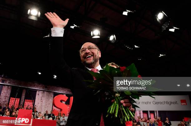 TOPSHOT Former European parliament president and candidate for Chancellor of Germany's social democratic SPD party Martin Schulz reacts after his...