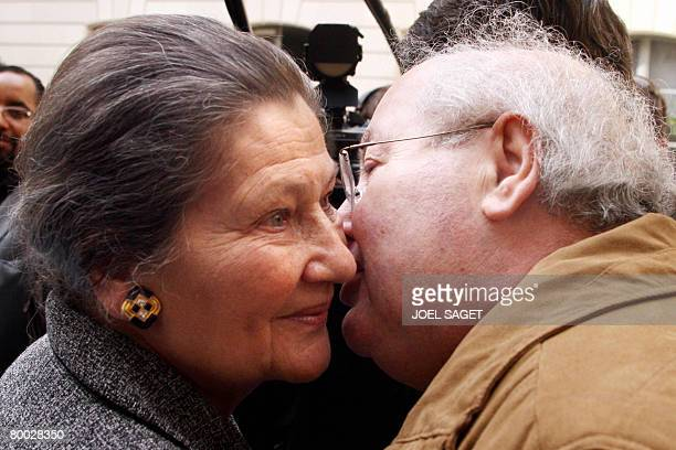 Former European Parliament President and President of the Foundation for the Memory of the Shoah Simone Veil is kissed by French lawyer Serge...