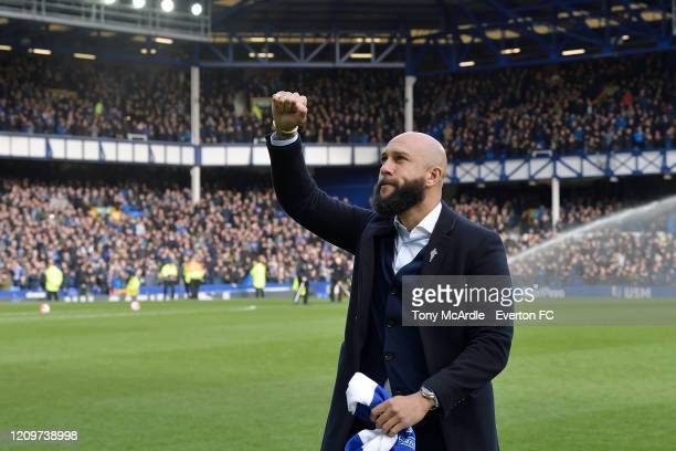 Former Everton Goalkeeper Tim Howard greets the fans during the Premier League match between Everton FC and Manchester United at Goodison Park on...