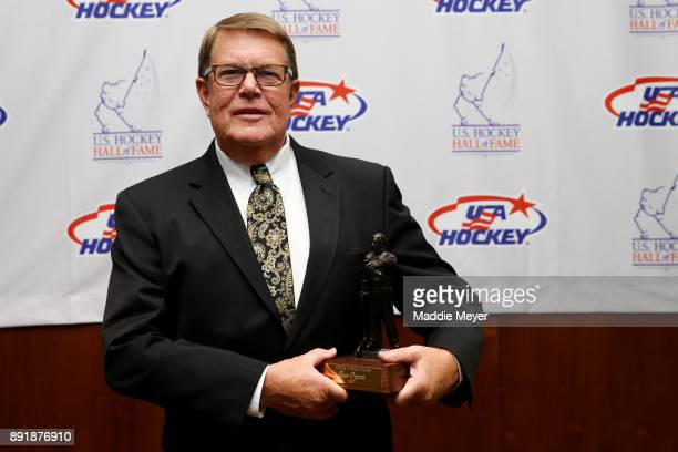 Former executive director of USA Hockey Dave Ogrean stands with his 2017 Lester Patrick Trophy before the US Hockey Hall of Fame Induction at Westin...