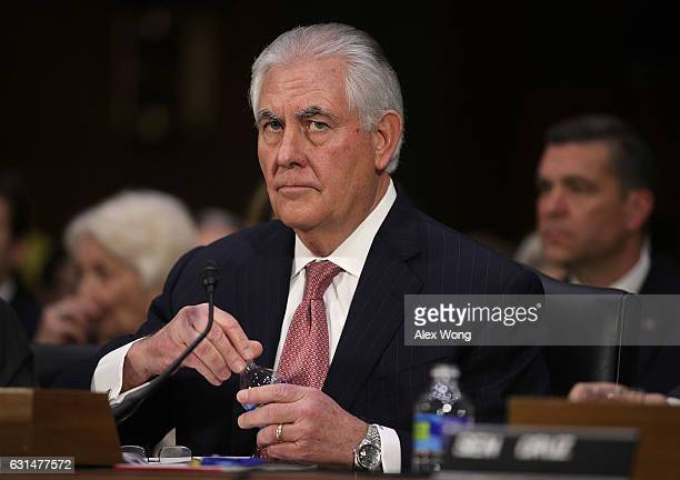 Former ExxonMobil CEO Rex Tillerson US Presidentelect Donald Trump's nominee for Secretary of State waits for the beginning of his confirmation...