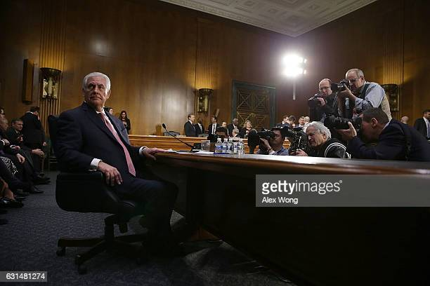 Former ExxonMobil CEO Rex Tillerson US Presidentelect Donald Trump's nominee for Secretary of State waits to resume testifying after a short break...