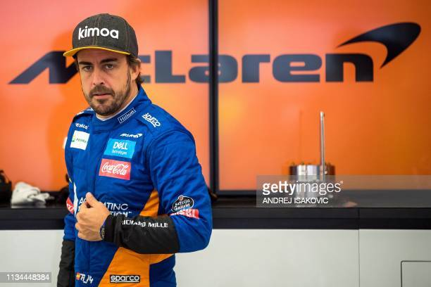 Former F1 driver and Two-time world champion Fernando Alonso looks on in McLaren's garage during tests at the Sakhir circuit in the desert south of...