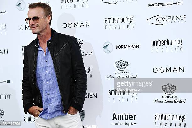 Former F1 driver Eddie Irvine arrives at the Amber Lounge fashion show during previews to the Monaco Formula One Grand Prix at Circuit de Monaco on...