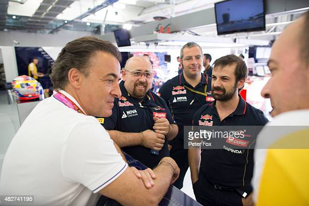 Former F1 driver Jean Alesi visits the Scuderia Toro Rosso garage during practice for the Bahrain Formula One Grand Prix at the Bahrain International...