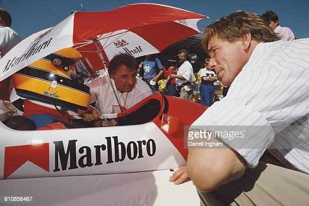 Former F1 World Champion James Hunt talks to Eddie Irvine aboard the Pacific Racing Reynard 89D Mugen before the start of the FIA International F3000...