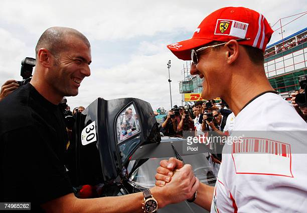 Former F1 World Champion Michael Schumacher of Germany takes former footballer Zinedine Zidane of France for a drive in a Ferrari round the circuit...