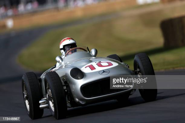 Former F1 World Champion Sir Jackie Stewart drives the 1954 Mercedes W196 as he takes part in the Goodwood Festival of Speed on July 14 2013 in...
