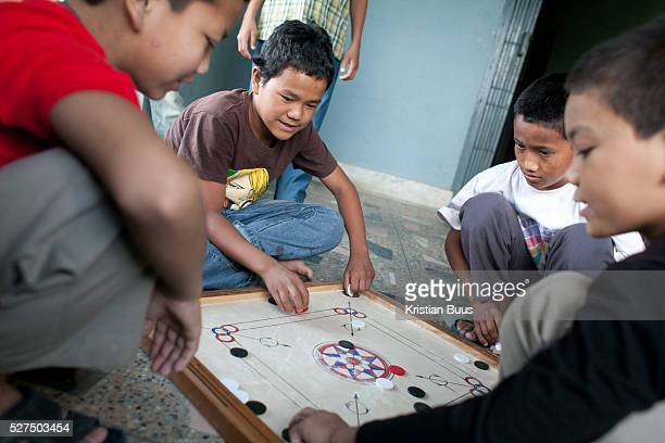 Former factory workers boys playing Ludo a popular Nepalese past time The Nepal Good Weave Foundation work to get all children out of the carpet...