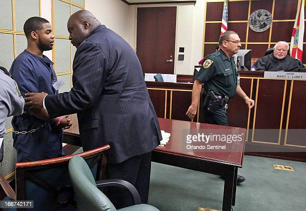 Former FAMU percussionist Caleb Jackson left confers with his attorney Chuck Hobbs Tuesday April 16 2013 after Jackson pleaded 'no contest' to Judge...