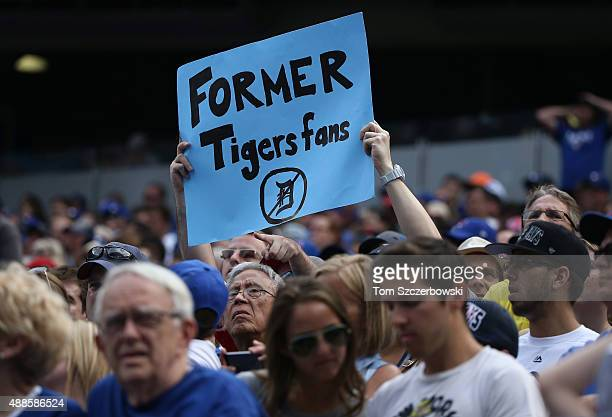Former fan of the Detroit Tigers holds up a sign expressing his apostasy during MLB game action against the Toronto Blue Jays on August 29, 2015 at...