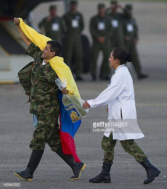 Former FARC hostage arrives with a Colombian national flag in Villavicencio, Colombia on April 2 after being liberated. Colombia's leftist...