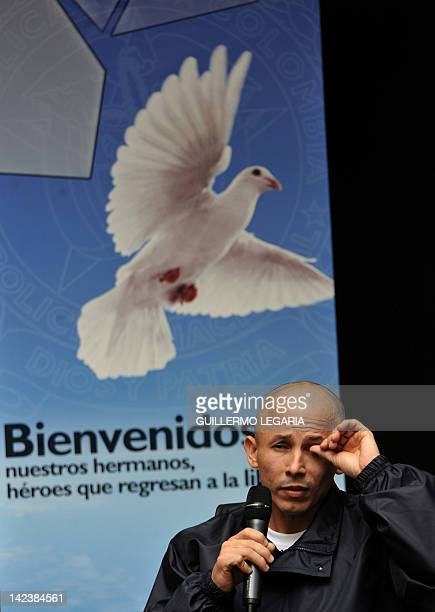 Former FARC hostage Colombian Police Intendant Wilson Rojas Medina gestures during a press conference offered by the six police officers released at...