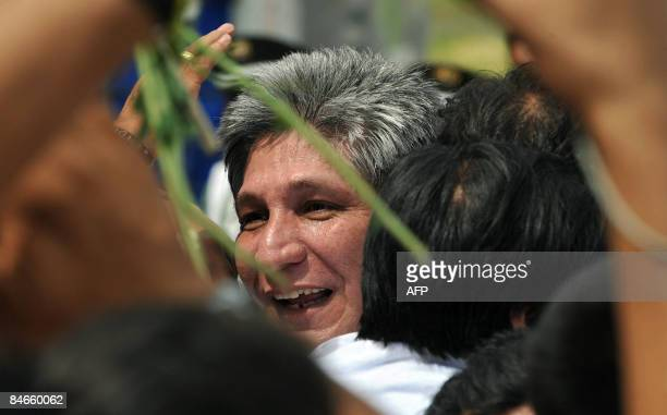 Former FARC hostage Sigifredo Lopez is hugged by friends upon his arrival at the Alfonso Bonilla Aragon airport in Palmira Valle del Cauca on...