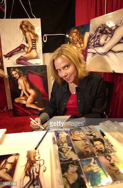 Former fashion designer Jennifer Janesko sketches at her booth at the fifth annual Erotica LA adult entertainment trade show July 14 2001 in Los...