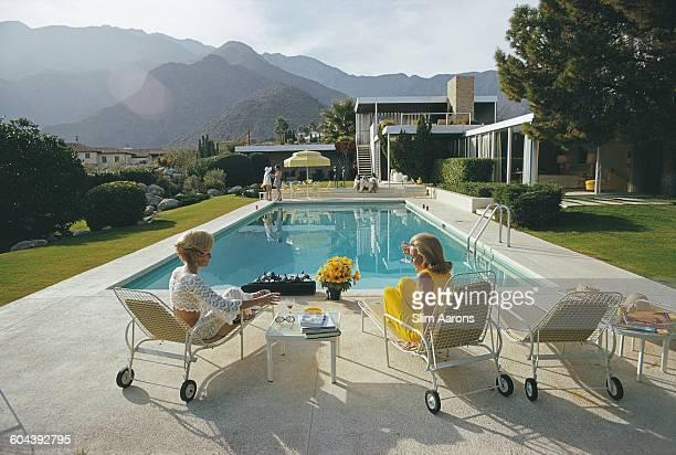 Former fashion model Helen Dzo Dzo Kaptur and Nelda Linsk wife of art dealer Joseph Linsk at the Kaufmann Desert House in Palm Springs California...