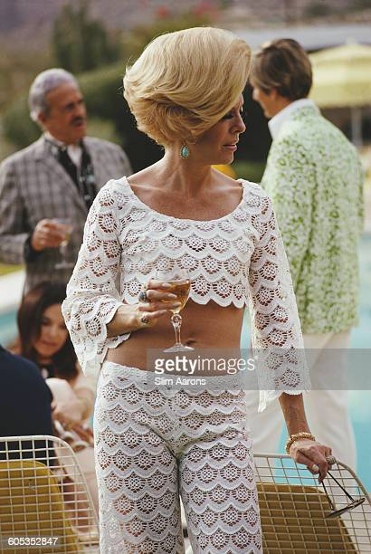 Former fashion model Helen Dzo Dzo Kaptur and other guests at the Kaufmann Desert House in Palm Springs California January 1970