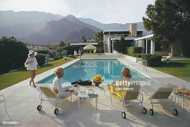 Former fashion model Helen Dzo Dzo Kaptur Nelda Linsk wife of art dealer Joseph Linsk and actress Lita Baron at the Kaufmann Desert House in Palm...