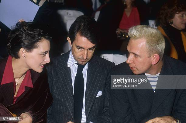 Former fashion model Ines de la Fressange, her husband Luigi d'Urso, and designer Jean-Paul Gaultier attend the Lanvin spring-summer 1990 fashion...