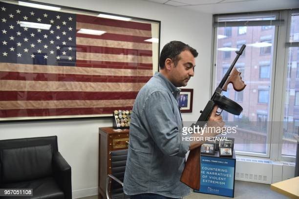 Former FBI Agent Ali Soufan holds an old FBI weapon during a interview with AFP in New York City on April 23 2018 To television viewers he is the FBI...