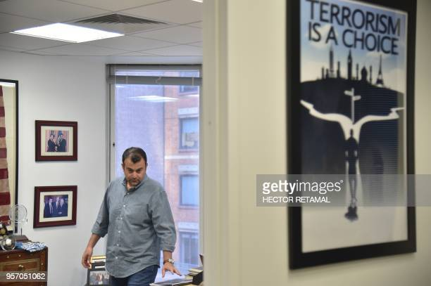 Former FBI Agent Ali Soufan walks in his office during an interview with AFP in New York City on April 23 2018 To television viewers he is the FBI...