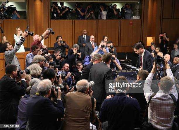 Former FBI Director James Comey arrives at the witness table before the Senate Intelligence Committee in the Hart Senate Office Building on Capitol...