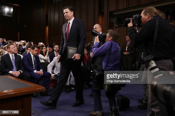 Former FBI Director James Comey arrives before testifying to the Senate Intelligence Committee in the Hart Senate Office Building on Capitol Hill...