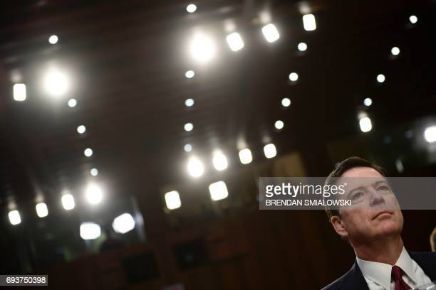 Former FBI Director James Comey arrives to testify during a US Senate Select Committee on Intelligence hearing on Capitol Hill in WashingtonDC June 8...