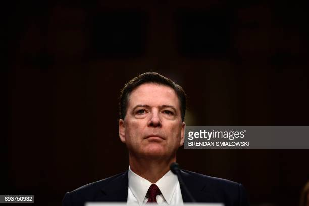 TOPSHOT Former FBI Director James Comey arrives to testify during a US Senate Select Committee on Intelligence hearing on Capitol Hill in...