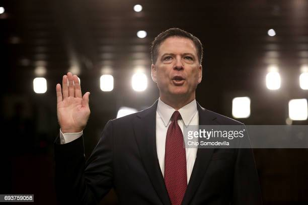 Former FBI Director James Comey is sworn in while testifying before the Senate Intelligence Committee in the Hart Senate Office Building on Capitol...