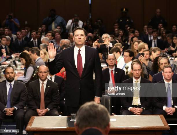 Former FBI Director James Comey is swornin before testifing before the Senate Intelligence Committee in the Hart Senate Office Building on Capitol...
