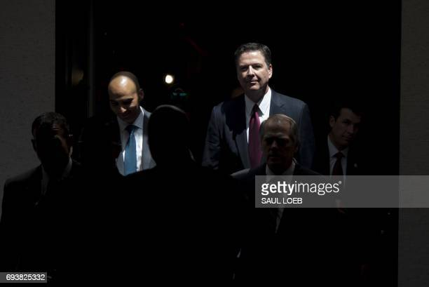 Former FBI Director James Comey leaves after testifying during a closeddoor US Senate Select Committee on Intelligence hearing on Capitol Hill in...