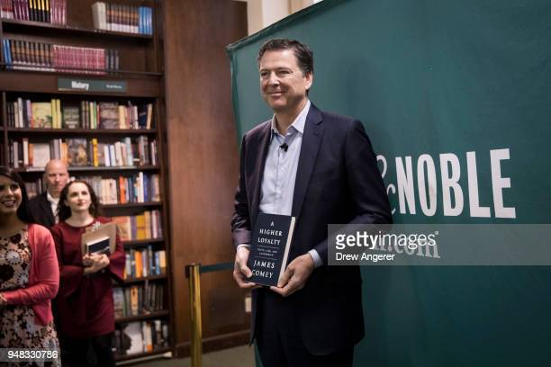 Former FBI Director James Comey poses for photographs as he arrives to speak about his new book 'A Higher Loyalty Truth Lies and Leadership' at...