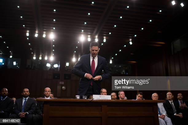 Former FBI Director James Comey prepares to be sworn in before testifying about his dealings with President Trump during a Senate Select Intelligence...
