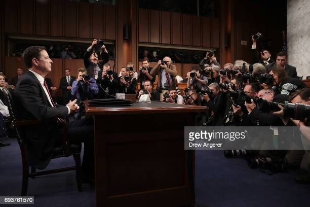 Former FBI Director James Comey prepares to testify before the Senate Intelligence Committee in the Hart Senate Office Building on Capitol Hill June...