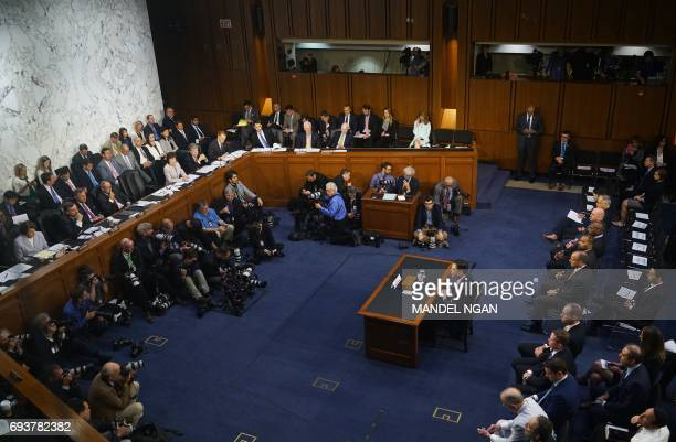 Former FBI director James Comey speaks during a hearing before the Senate Select Committee on Intelligence on Capitol Hill June 8 2017 in Washington...