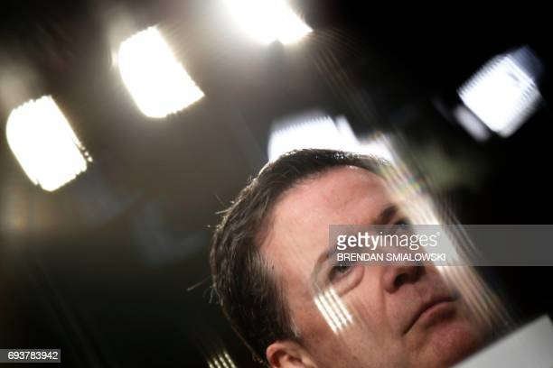 TOPSHOT Former FBI director James Comey speaks during a hearing before the Senate Select Committee on Intelligence on Capitol Hill June 8 2017 in...