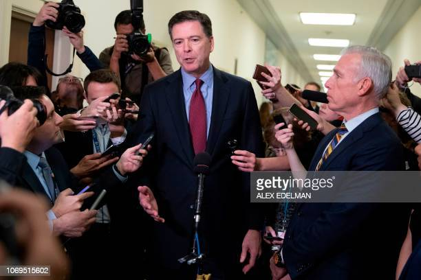 Former FBI Director James Comey talks to reporters following a closed House Judiciary Committee meeting to hear his testimony on Capitol Hill in...