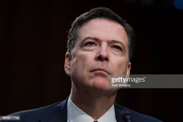 Former FBI Director James Comey testifies before a Senate Select Intelligence Committee hearing on Russian interference in the 2016 election on June...
