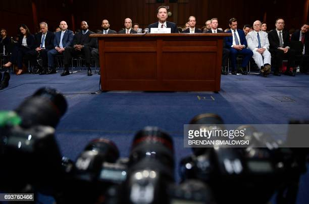 TOPSHOT Former FBI Director James Comey testifies during a US Senate Select Committee on Intelligence hearing on Capitol Hill in Washington DC June 8...