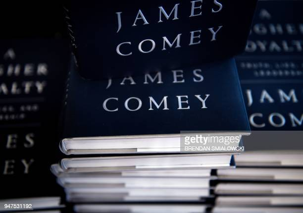 Former FBI Director James Comey's new book A Higher Loyalty is selling at Kramerbooks on April 17 in Washington DC / AFP PHOTO / Brendan Smialowski