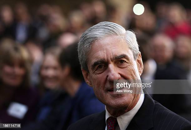 Former FBI director Robert Mueller attends the ceremonial swearingin of FBI Director James Comey at the FBI Headquarters October 28 2013 in...