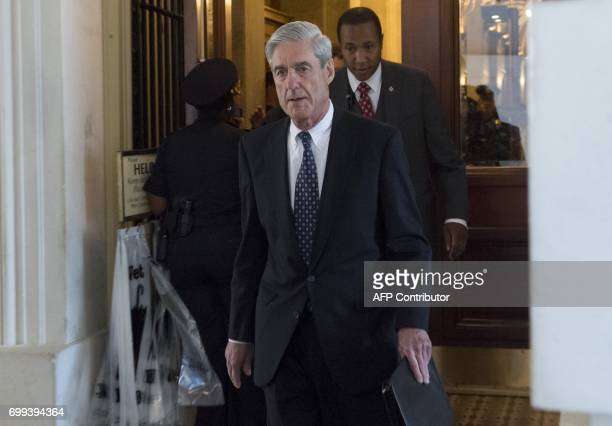 Former FBI Director Robert Mueller special counsel on the Russian investigation leaves following a meeting with members of the US Senate Judiciary...