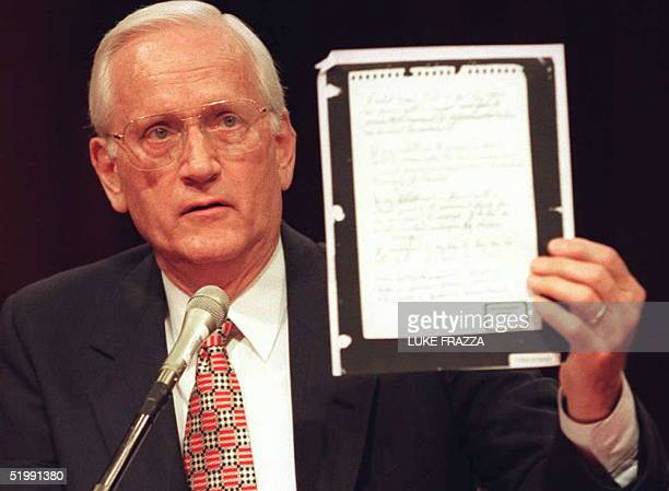 Former FBI Director William Sessions holds up a copy of the rules of engagement that were used in the 1992 incident at Ruby Ridge Idaho during Senate...