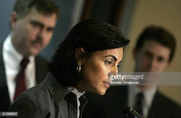 Former FBI translator and whistleblower Sibel Edmonds speaks as her lawyers Roy Krieger and Mark Zaid stand nearby during a media conference at the...