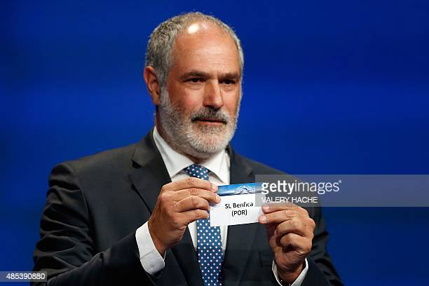 Former FC Barcelona player Andoni Zubizarreta shows the name of Benfica during the UEFA Champions League Group stage draw ceremony on August 27 2015...
