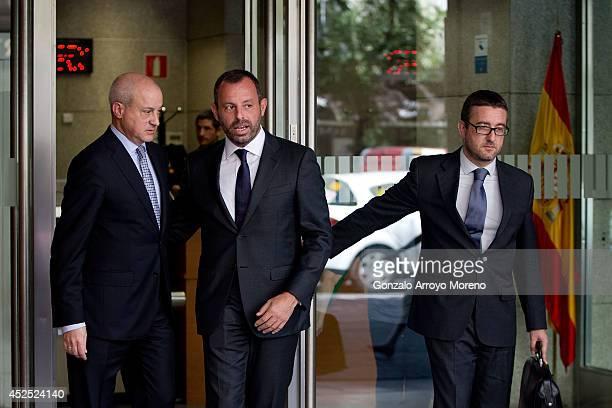 Former FC Barcelona president Sandro Rosell leaves Spain's High Court in company of his lawyers on July 22 2014 in Madrid Spain Former FC Barcelona...