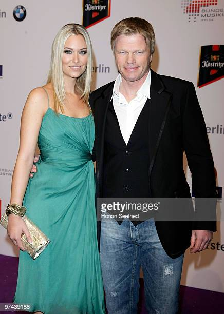 Former FC Bayern goalkeeper Oliver Kahn and model Svenja arrive at the Echo Award 2010 at Messe Berlin on March 4 2010 in Berlin Germany