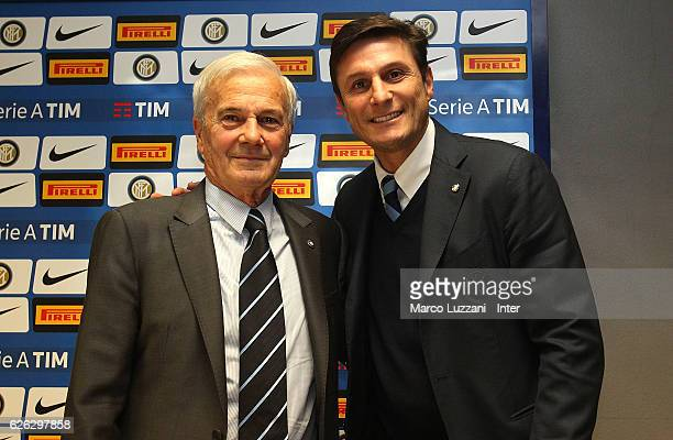 Former FC Internazionale coach Luigi Simoni and former player Javier Zanetti pose for a photo during a press conference to present Simoni's biography...