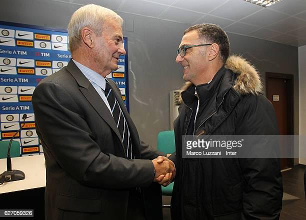 Former FC Internazionale coach Luigi Simoni shakes hands with Giuseppe Bergomi during a press conference to present his biography 'Simoni si nasce...